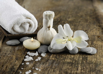 white orchid , stones ,candle ,towel on old wood background