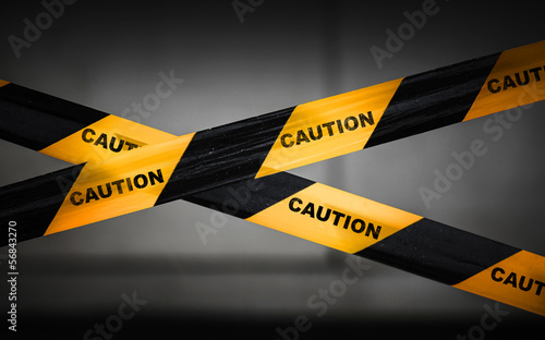 Black and yellow striped caution tape barrier