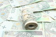 Roll of tied banknotes on money background