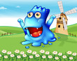 A happy blue monster at the hiltop with a windmill