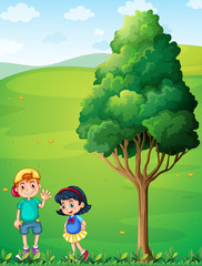 Two kids at the hilltop near the tree