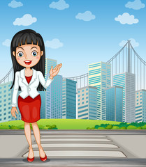 A pretty woman presenting the tall buildings