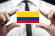 Businessman holding a business card with a Colombia Flag