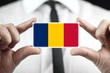 Businessman holding a business card with a Chad Flag