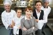 Leinwandbild Motiv Cute female manager posing with the staff