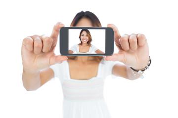 Happy asian woman taking a selfie