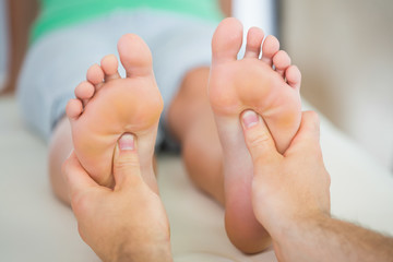 Physiotherapist giving a patient a foot massage