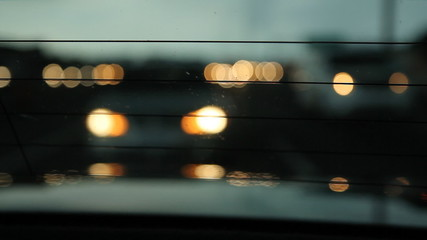 View through rear of car window.  401 highway in Toronto.