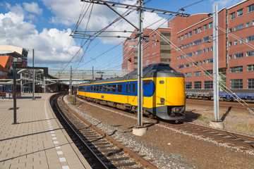 Train leaving Dutch station of Amersfoort