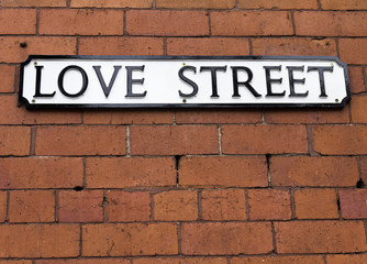 Love Street Sign on a red brick wall