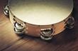 Leinwanddruck Bild - Wooden tambourine on a table