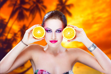 Tropical woman with oranges