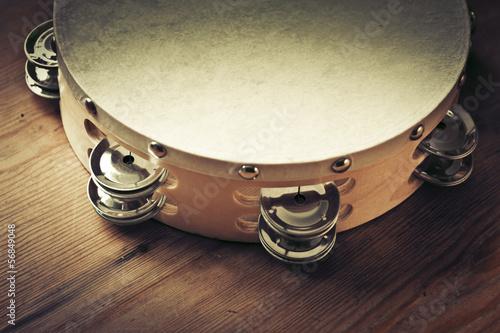 Leinwanddruck Bild Wooden tambourine on a table