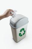 hand putting a paper garbage into recycling bin