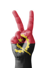 Hand making the V sign, Angola flag painted
