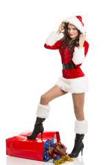 Sexy Santa girl with Christmas red shopping bag