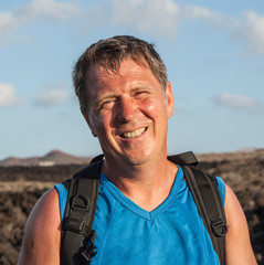 man on walking trail in volcanic area