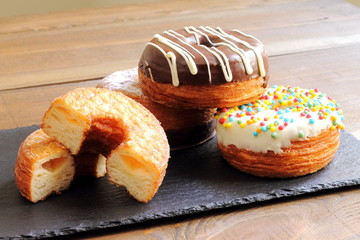 Trendy puff pastries, half croissant and half donut