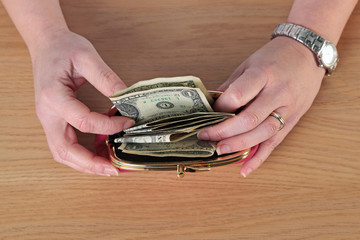 Woman taking money out of her purse