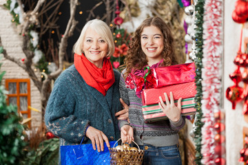 Happy Mother And Daughter With Christmas Presents In Store
