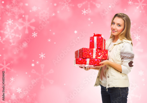 Girl with gift boxes on winter background