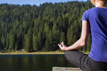 yoga and meditation near mountain lake