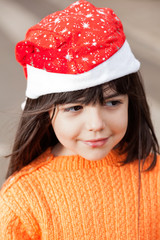 Girl In Santa Hat Looking Away