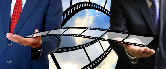 Businessman send movie film to buyer, Movie business concept