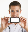 Young medical doctor man showing screen of smartphone. Isolated.