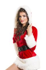 Sexy beautiful woman posing in Santa Claus costume
