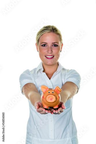 Frau mit einem Sparschwein