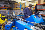Factory Engineer Operating Hydraulic Tube Bender