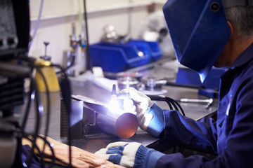 Factory Engineer Operating TIG Welding Machine