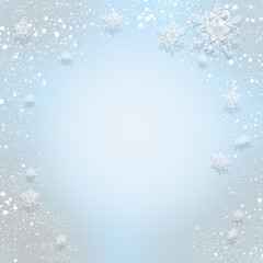 Gentle blue abstract Christmas background with snowflakes that f