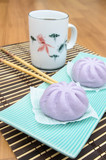 Taro Mantou Chinese steamed bun in green dish on bamboo mat