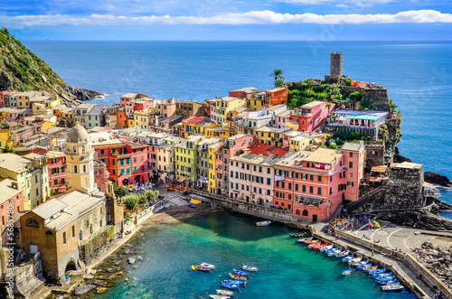 Scenic view of ocean and harbor in colorful village Vernazza