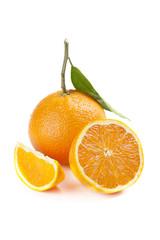 Ripe orange fruit with leaf isolated on white background