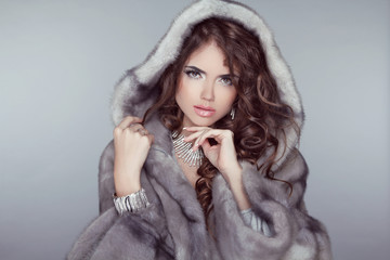 Fashion beautiful woman posing in fur coat. Winter Girl  Model i