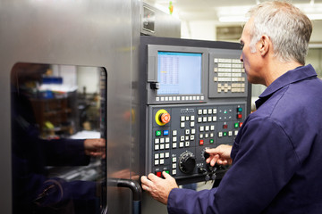 Engineer Operating Computer Controlled Lathe