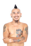 smiling asian punk guy with mohawk hair style, piercing, tattoo