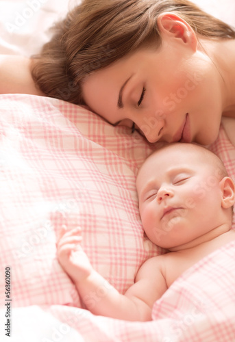 Mother with baby sleeping