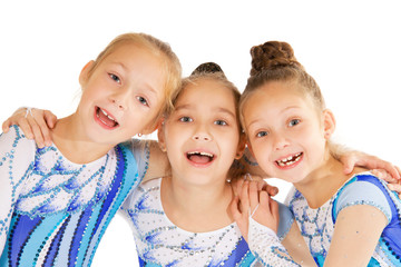 Portrait of little happy beautiful gymnasts
