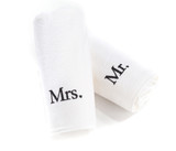 mr and mrs rolled white towels isolated on a white background