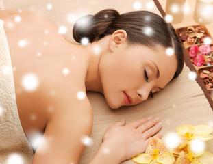 woman in spa salon lying on the massage desk