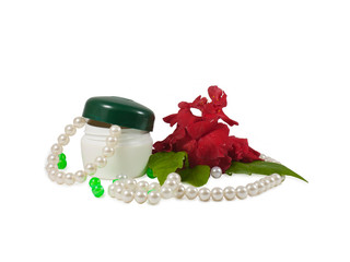 Cosmetic cream pearls and rose.