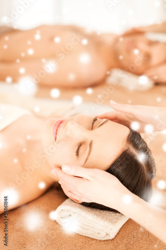 couple in spa salon getting face treatment