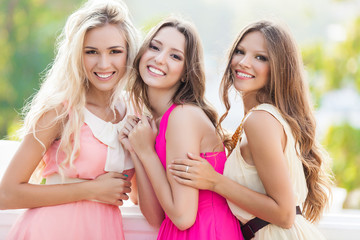 beautiful young female friends laughing