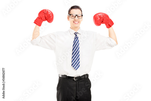 Excited man with tie and red boxing gloves, celebrating a win