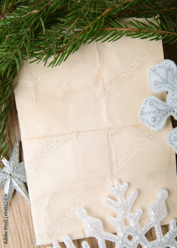 Beige paper background with Christmas tree and snowflakes