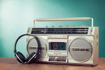 Retro cassette ghetto blaster and headphones on table